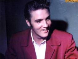 Elvis in dark red suite coat