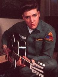 Elvis in US army uniform with guitar