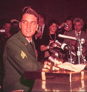 Elvis Presley in army uniform at a press conference