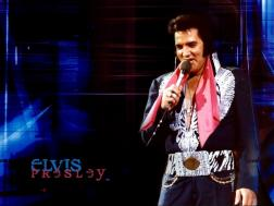 Elvis Presley in black and pink outfit