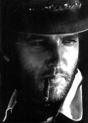 Elvis Presley in cowboy outfit_smooking cigar