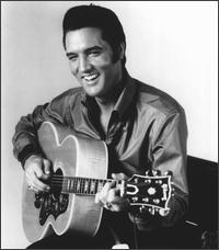 Black and white picture of Elvis Presley singing and playing guitar