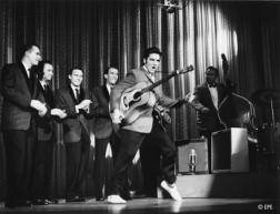 Elvis Presley singing and dancing