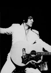 Elvis Presley singing and playing guitar