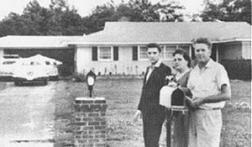 Elvis with his parents_first home bought for them
