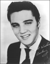 white and black picture of Elvis Presley smiling